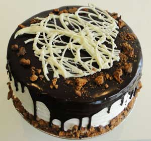 This Delight Has Layers Of Crushed Cookies In Between Thin Chocolate Cake Fudge And Cream All Finished With Pouring